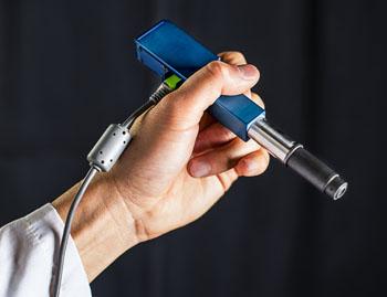 Image: The handheld MEMS microscope (Photo courtesy of Dennis Wise/University of Washington).