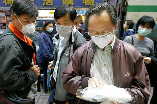 Image: Chinese citizens examining surgical masks during the SARS epidemic (Photo courtesy of Getty Images).