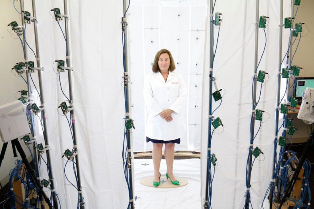 Image: Dr. Leslie Saxon standing in a virtual doctor photo tent (Photo courtesy of Eddie Sakaki/USC).