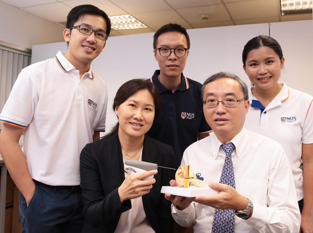 Image: NUS researchers with the handheld CLiKX device (Photo courtesy of NUS).