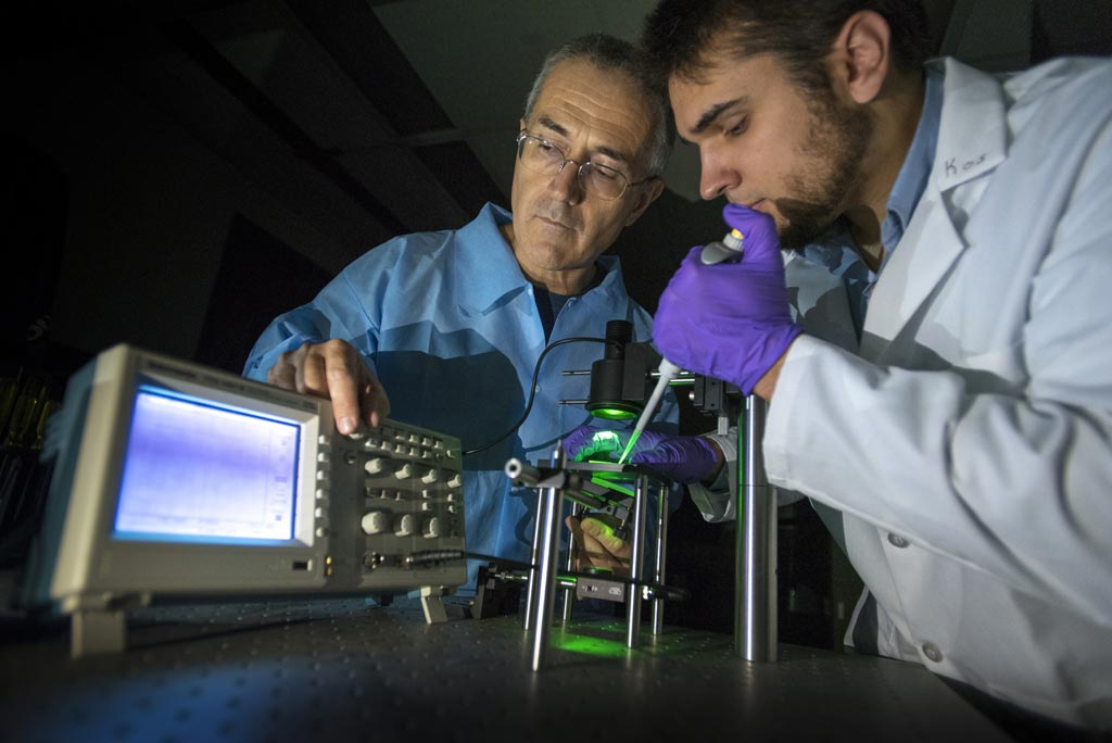 Image: UConn researchers George Lykotrafitis and Kostyantyn Partola with the whole blood rheometer (Photo courtesy of Sean Flynn / UConn).