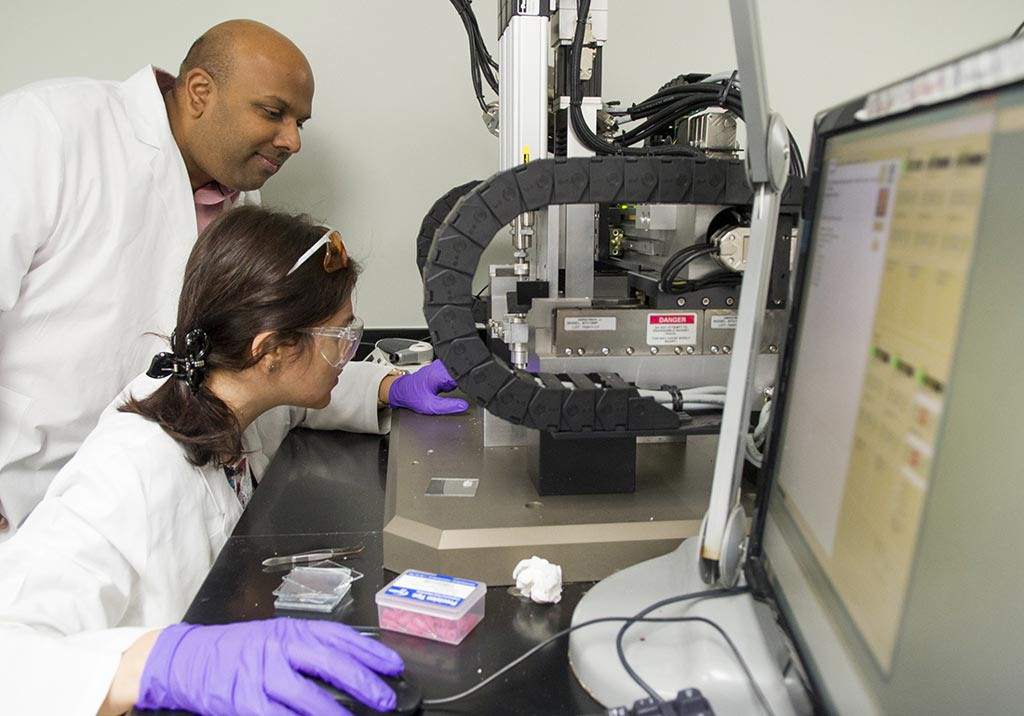 Image: Dr. Venu Varanasi and Research Assistant Tugba Cebe set the coordinates for the 3D printer (Photo courtesy of TAMU).