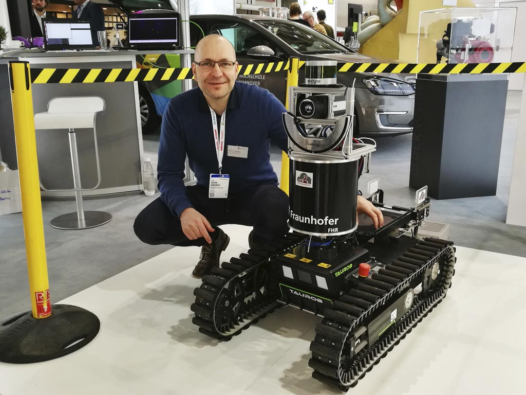Image: Professor Achim Lilienthal and the SmokeBot (Photo courtesy of ORU).