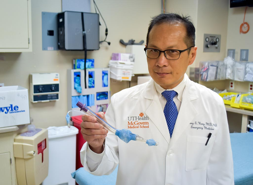 Image: Lead author Dr. Henry Wang holding a laryngeal tube (Photo courtesy of Rob Cahill/ UTHSCSA).