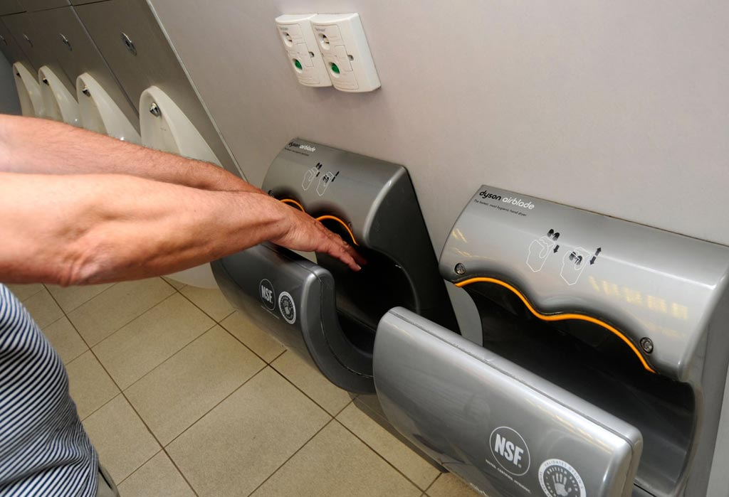 Image: A new study claims Airblades are cheaper to run but less hygienic than paper towels (Photo courtesy of Alamy).