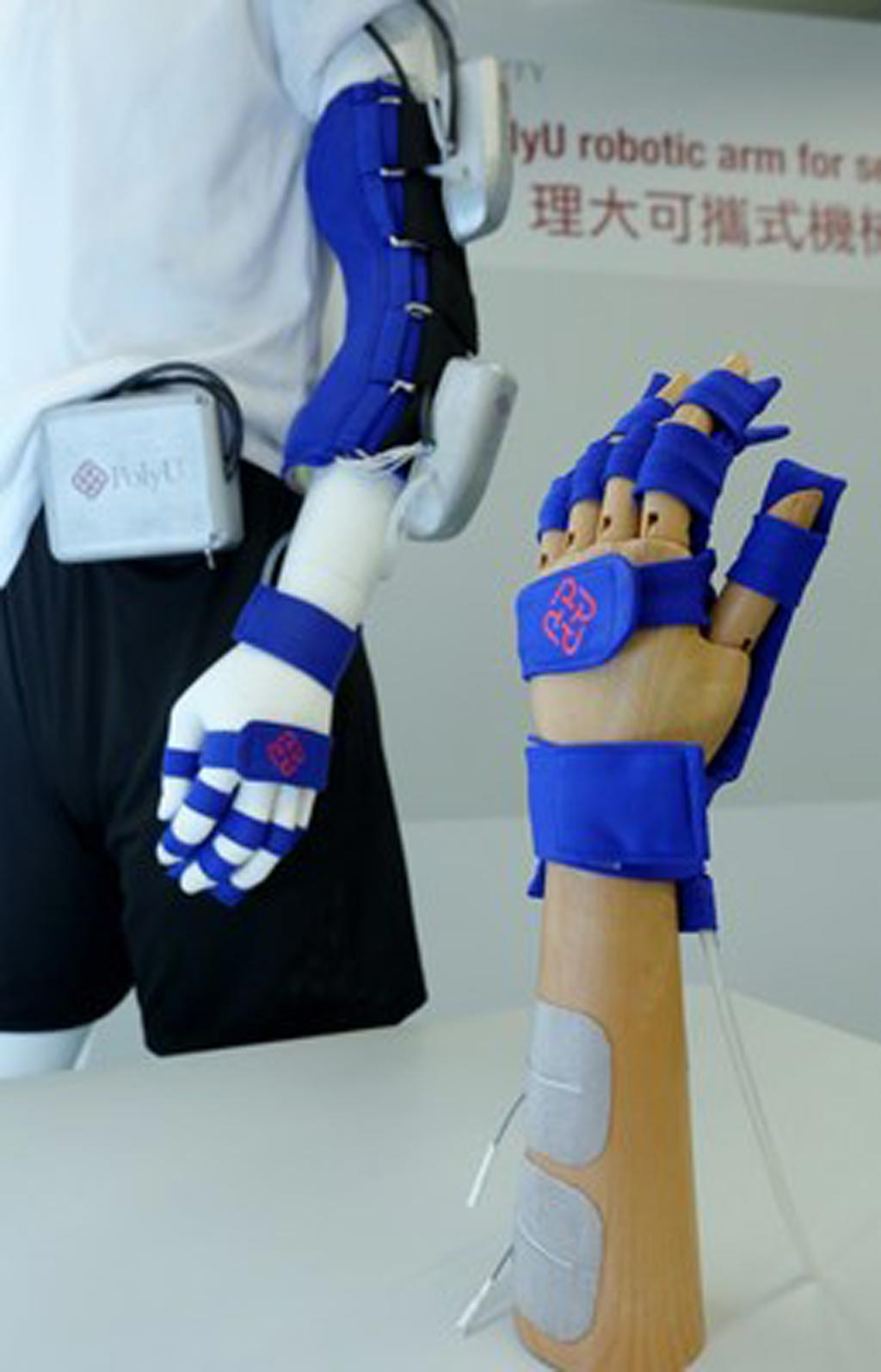 Image: A rehabilitation device combines an exo-skeleton and soft robotics (Photo courtesy of PolyU).