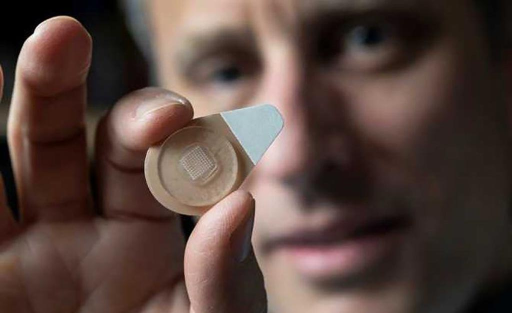 Image: Professor Mark Prausnitz holds an experimental microneedle contraceptive skin patch (Photo courtesy of Christopher Moore/Georgia Tech).
