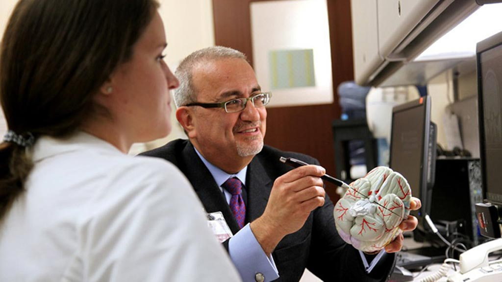 Image: Professor Issam Awad demonstrating the MISTIE procedure (Photo courtesy of University of Chicago).