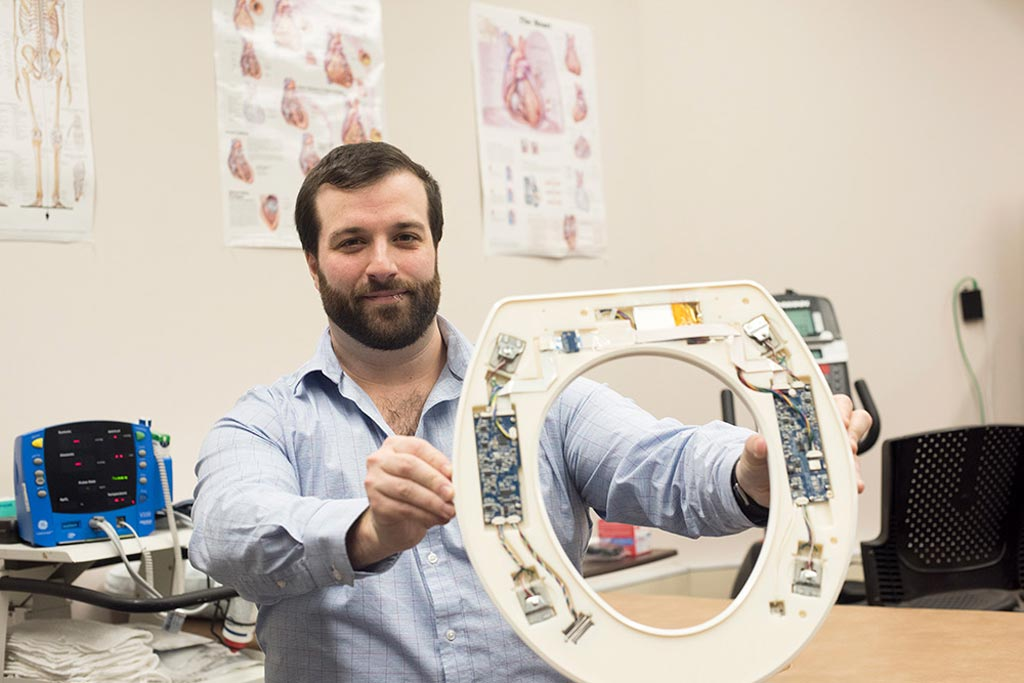 Image: Nicholas Conn presenting the toilet-seat based cardiovascular monitoring system (Photo courtesy of Sue Weisler/ RIT).