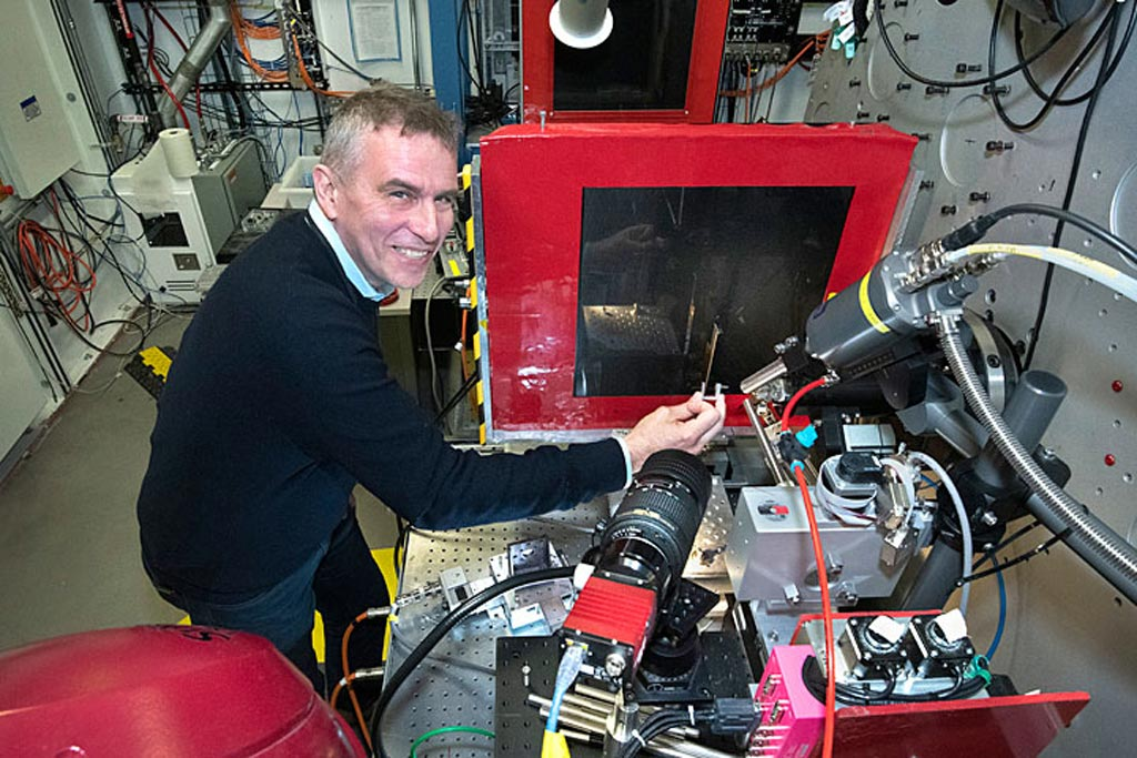 Image: Dr. Anatoly Frenkel next to the XPS powder diffraction beamline (Photo courtesy of BNL).