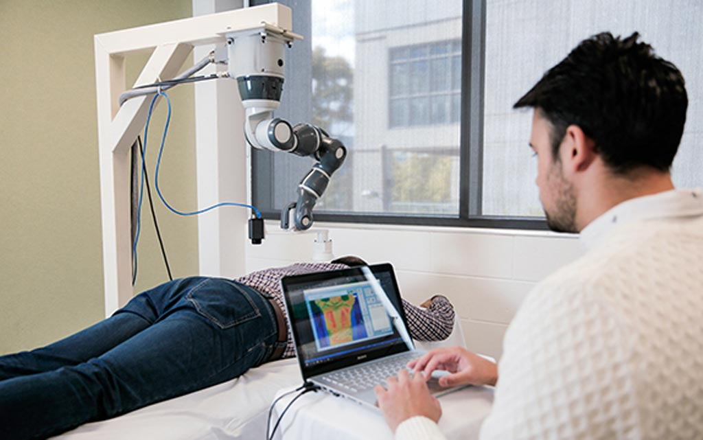 The PBM cobot applies targeted laser therapy to pain hot spots (Photo courtesy of Swinburne Institute of Technology).