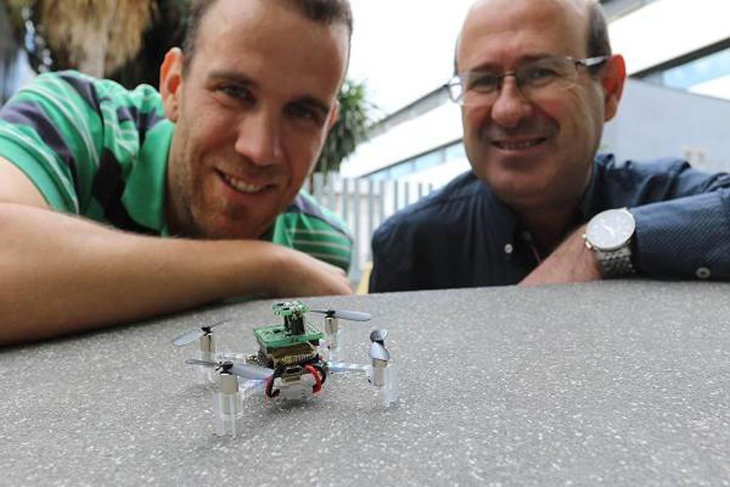 Image: Javier Burgués (L) and Santiago Marco (R), of UB and IBEC, and the nanodrone (Photo courtesy of IBEC).