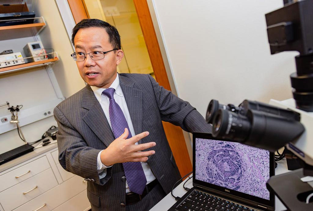 Image: Dr. Baowei Fei demonstrating HSI of tissue (Photo courtesy of UTD).