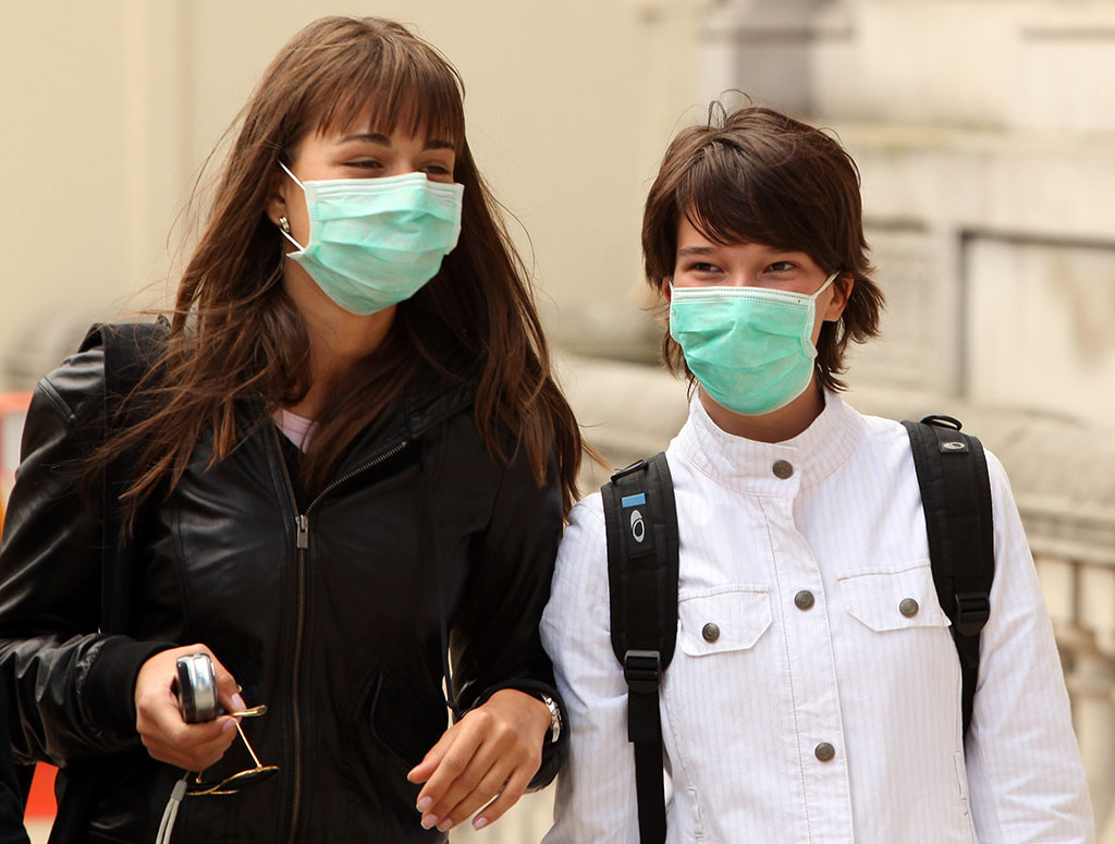 Image: The efficiency of common masks in containing SARS–CoV-2 is questionable (Photo courtesy of Getty Images).