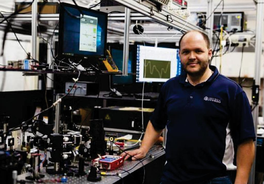 Image: Assistant Professor Shawn Putnam, PhD, of UCF\'s College of Engineering & Computer Science in his laboratory with the frequency-domain Faraday rotation spectroscopy (Photo courtesy of the University of Central Florida).