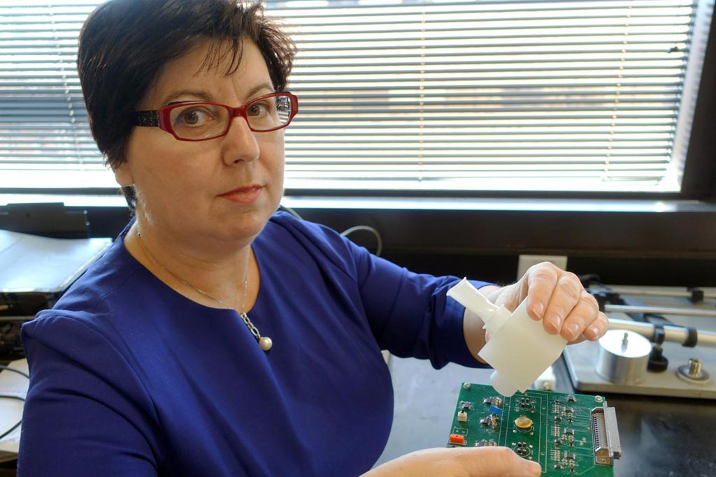 Image: Dr. Perena Gouma displays a hand-held breath monitor that can detect the flu virus (Photo courtesy of the University of Texas, Arlington).