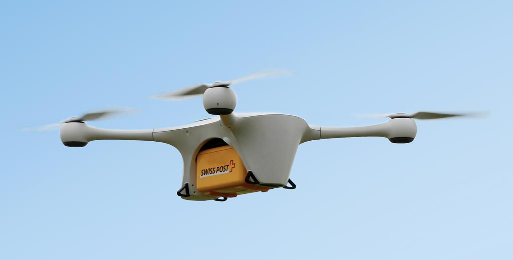 Image: A quadrocopter drone transporting a biological safety box (Photo courtesy of Swiss Post).