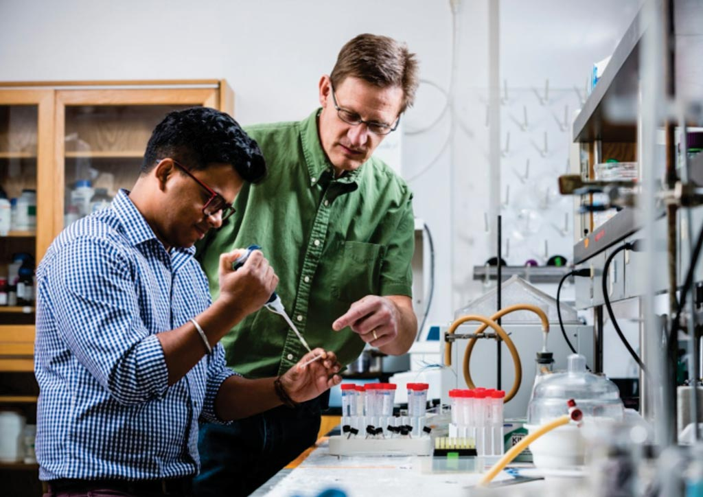 Image: Scientists loading the integrated electrokinetically driven microfluidic device with pH-mediated solid-phase extraction coupled to microchip electrophoresis for preterm birth biomarkers (Photo courtesy of Nate Edwards, Brigham Young University).