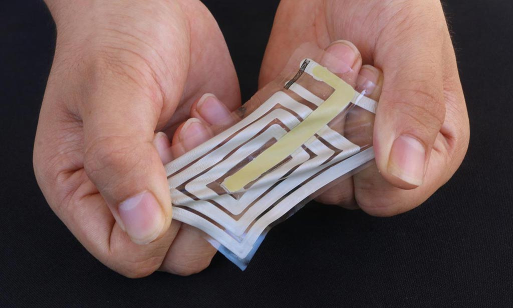 Image: Researchers used metallic ink to screen-print an antenna and sensor onto a stretchable sticker designed to adhere to skin and track pulse and other health indicators, and transmit these readings to a receiver on a person\'s clothing (Photo courtesy of Bao Lab, Stanford University).