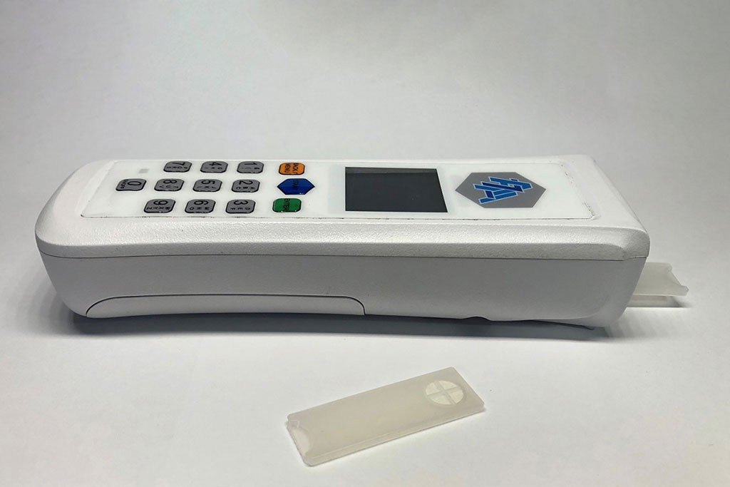 Image: A prototype of the handheld ammonia blood detector and associated test strips (Photo courtesy of Thomas Veltman).