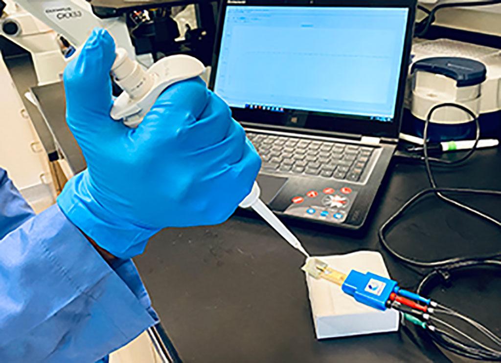 Image: Testing a nanotube-based electrochemical biosensor (Photo courtesy of University of Nevada)