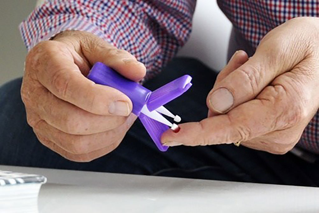 Image: A study participant collects blood at home using a Mitra device with VAMS technology from Neoteryx (Photo courtesy of Neoteryx)