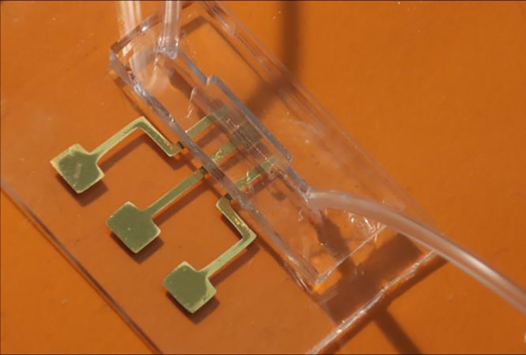 Image: An image of the COVID-19 test chip made by aerosol jet nanoparticle 3D printing (Photo courtesy of Carnegie Mellon University)