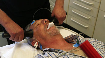 Image: A patient undergoing ECT treatment, which involves using small electric currents to trigger a short seizure in the brain (Photo courtesy of BBC Newsnight).