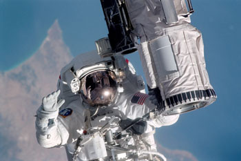 Image: Mission specialist Michael Gernhardt performing a spacewalk (Photo courtesy of NASA).