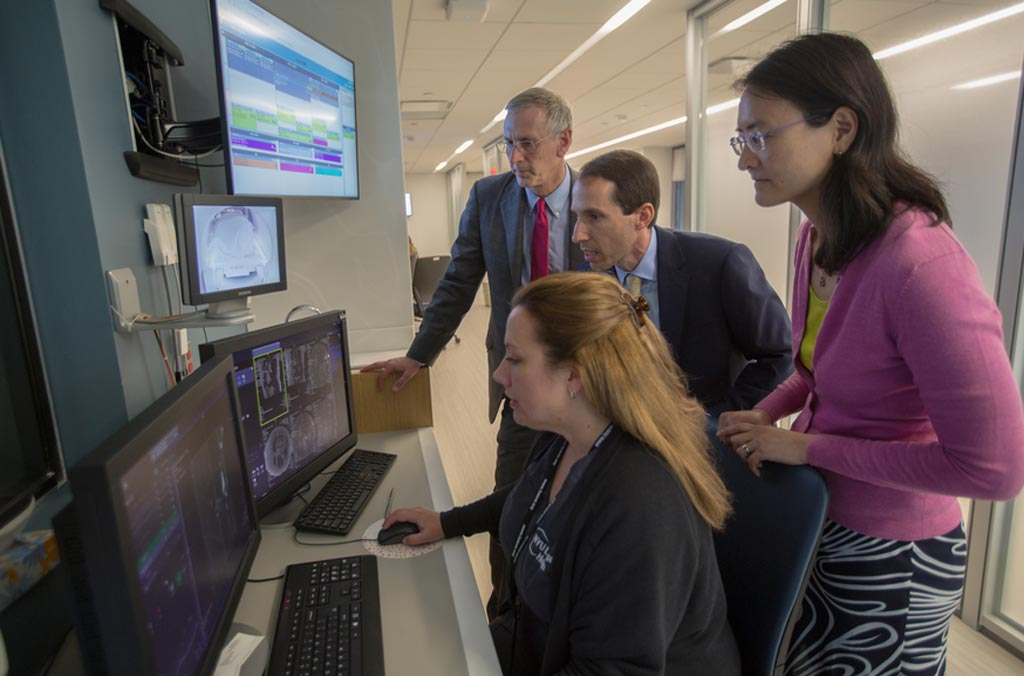 Image: NYU School of Medicine Department of Radiology chair, Michael Recht, MD; Daniel Sodickson, MD, PhD, vice chair for research and director of the Center for Advanced Imaging Innovation and Research; and Yvonne Lui, MD, director of artificial intelligence, watch an MRI exam take place with at NYU Langone Health in New York in August 2018.