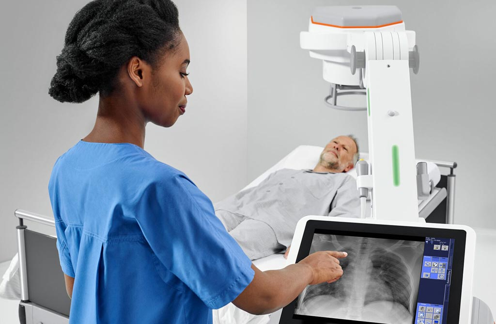 Image: Radiographer using the MOBILETT Elara Max mobile X- ray machine (Photo courtesy of Siemens Healthineers).