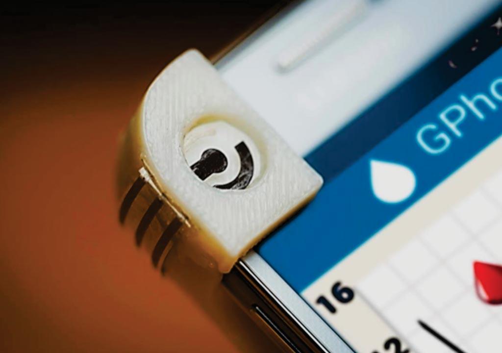 图片:GPhone是集成到智能手机上的一部便携式葡萄糖传感系统(图片蒙David Baillot/加州大学圣迭戈分校雅各布斯工学院惠赐)。