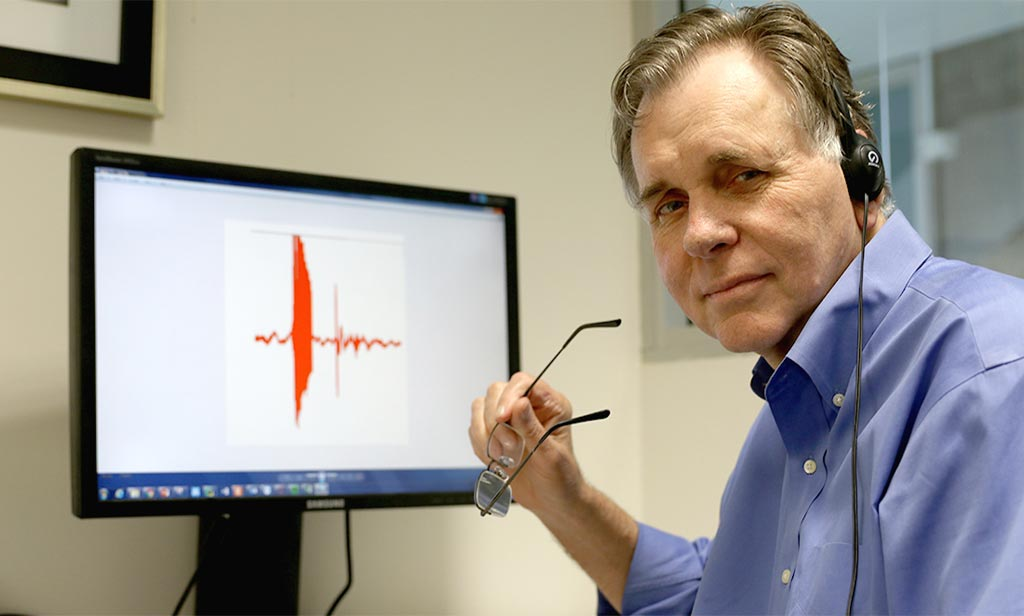 Image: Professor Barry Marshall listening to a gut recording (Photo courtesy of Scitech.org.au).