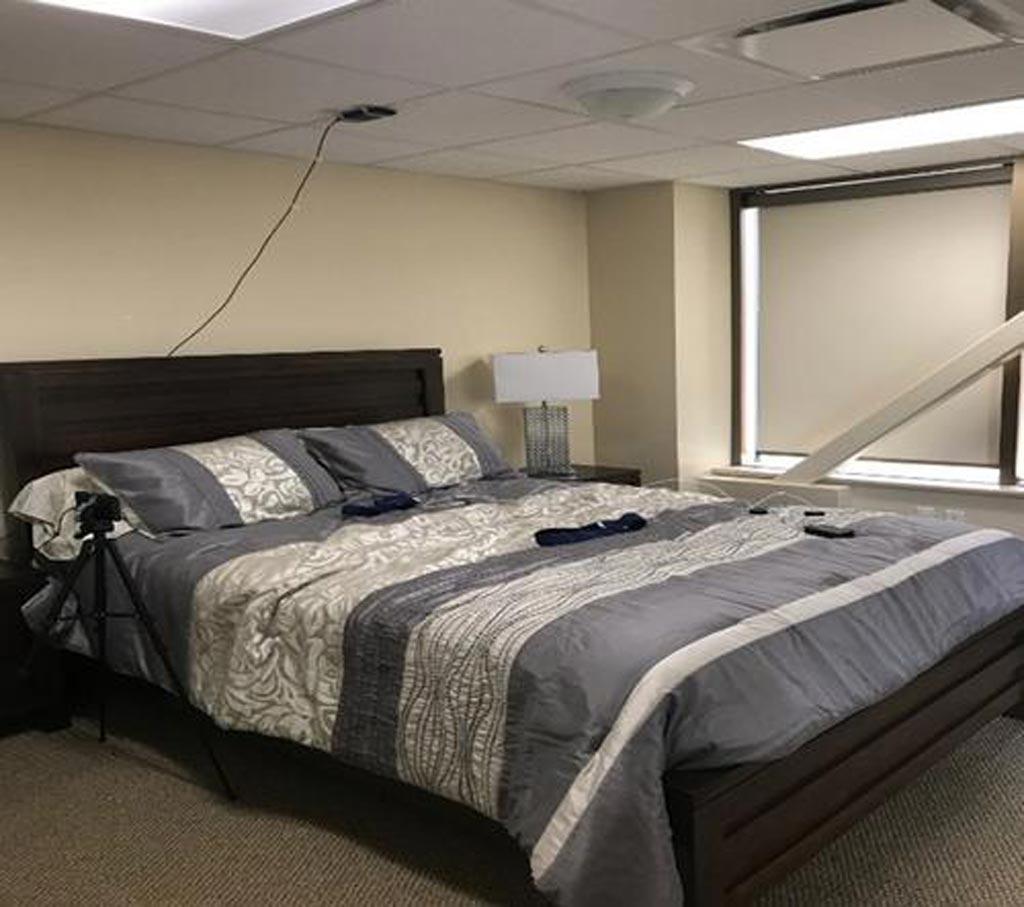 Image: The model long-term care apartment used in the study and the ceiling mounted FMCW radar (Photo courtesy UW).