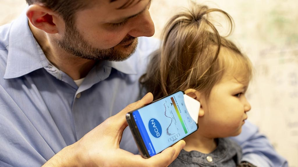 Image: Dr. Randall Bly of Seattle Children\'s Hospital checking his daughter\'s ear (Photo courtesy of Dennis Wise/ UW).