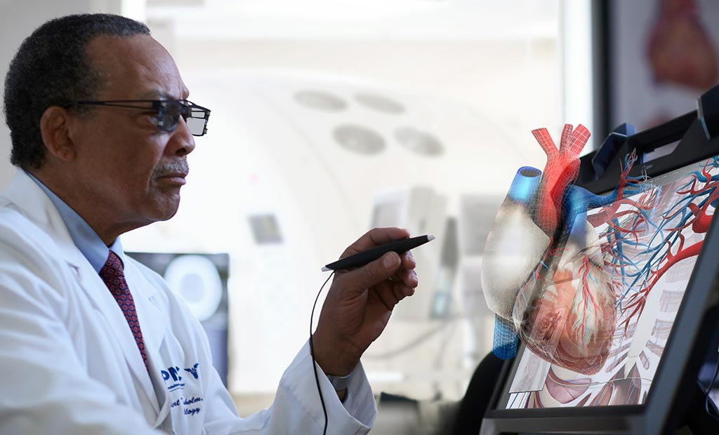 Image: VR glasses and an electronic scribe help manipulate a holographic heart (Photo courtesy of EchoPixel).