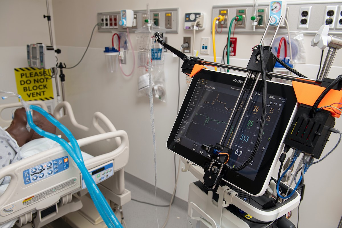 Image: A robotic assistant adjusts ventilator parameters remotely (Photo courtesy of JHU)