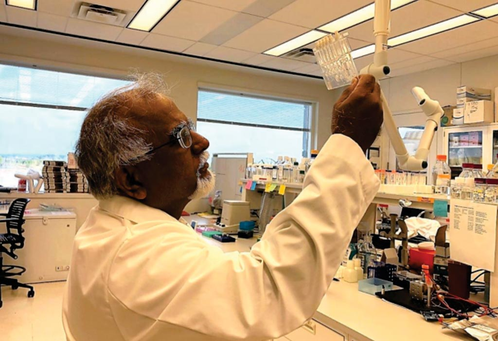 Image: Dr. Krishnan Chittur, PhD, chief technology officer and co-founder of GeneCapture, holds the prototype of the rapid infection test cartridge (Photo courtesy of GeneCapture).