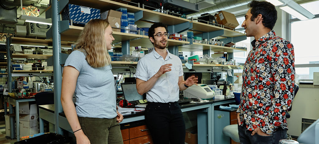 Image: Researchers in the Blake Wiedenheft Lab, from left, Laina Hall, undergraduate research assistant, Andrew Santiago-Frangos, postdoctorate fellow, and Pushya Krishna, undergraduate research assistant, helped repurpose a CRISPR system to make rapid, accurate COVID-19 test. (Photo courtesy of Adrian Sanchez-Gonzalez)