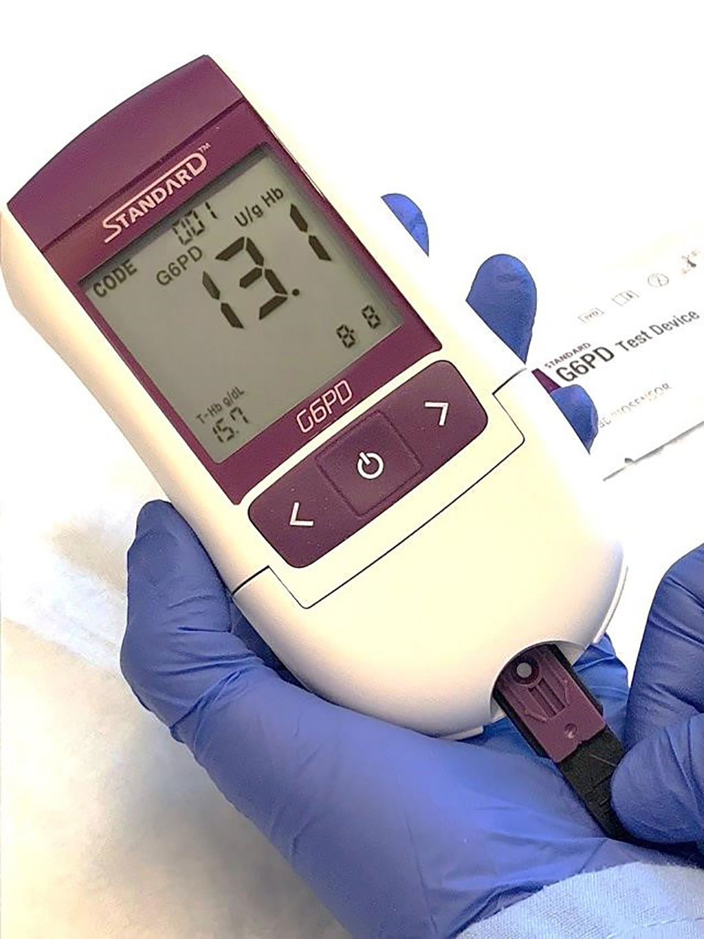 Image: The STANDARD G6PD Test is a handheld device that delivers results in two minutes and provides a quantitative measure of G6PD activity, including in heterozygous women (Photo courtesy of SD BIOSENSOR/PATH)