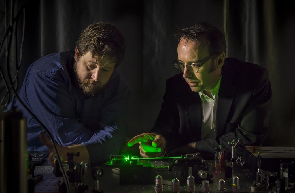 Image: Professor Robert McLaughlin (R) with the smart needle (Photo courtesy University of Adelaide).
